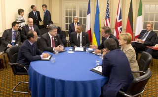 President Obama meets with German Chancellor Angela Merkel (second from right), Ukrainian President Petro Poroshenko and NATO leaders, Newport, Wales September 4, 2014. President Obama, Merkel and Poroshenko discussed the Ukraine cease-fire agreement yesterday. Photo by Alain Jocard/Reuters