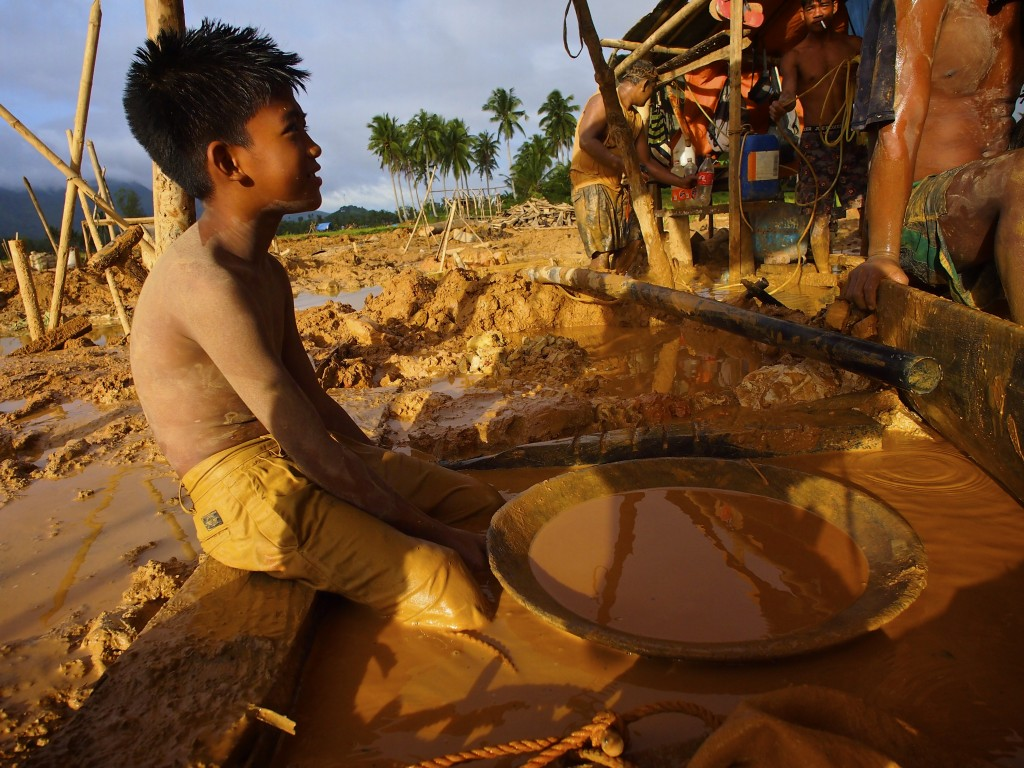 Compressor miners working in the gold fields at Dalas Labo, a village in the provide of Camarines Norte on the island of Luzon. Photo by Larry C. Price