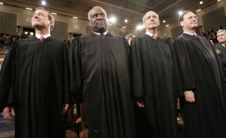 File photo of Supreme Court justices by Pablo Martinez Monsivais/Reuters