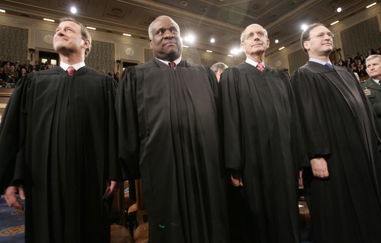 File photo of Supreme Court justices by Pablo Martinez Monsivais/Reuters