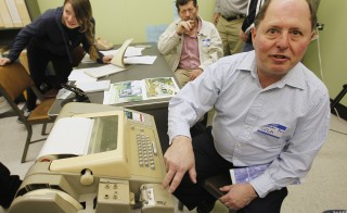 Internet technology consultant and former UCLA graduate student Charley Kline sits next to a teletype similar to the one used to communicate with the Sigma 7 computer at the grand opening of the Kleinrock Internet Heritage Site and Archive in 3420 Boelter Hall, birthplace of the Internet. Photo by Fred Prouser/Reuters