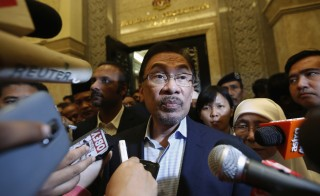 Malaysia's opposition leader Anwar Ibrahim speaks to the media after his final appeal against a conviction for sodomy concluded at the Palace of Justice in Putrajaya Nov. 7. Photo by Olivia Harris/Reuters