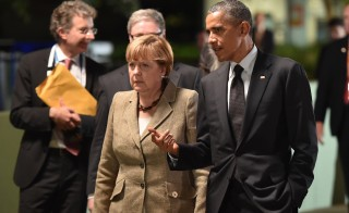 German Chancellor Angela Merkel, seen here with U.S. President Barack Obama in Brisbane, Australia in November, will visit Washington to discuss the politics of aiding Ukraine. Photo by REUTERS/Peter Parks/Pool