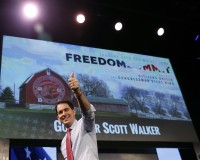 Wisconsin Governor Walker walks off the stage after speaking at the Freedom Summit in Des Moines