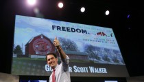 Wisconsin Governor Scott Walker walks off the stage after speaking at the Freedom Summit in Des Moines, Iowa on January 24, 2015.  Photo by Jim Young and Reuters.