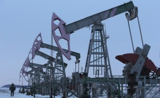 A worker walks past pump jacks on an oil field owned by Bashneft company near the village of Nikolo-Berezovka, northwest from Ufa, Bashkortostan, Jan. 28, 2015. New European Union sanctions against Russia could possibly affect the country's access to advanced technology for the oil and gas sectors, EU officials said. Photo by Sergei Karpukhin/Reuters