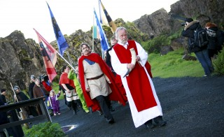 High priest of the Asatru Association, Hilmar Orn Hilmarsson, leads a procession of fellow members of the Asatru Association, a contemporary Icelandic pagan society, at the Pingvellir National Park near Reykjavik June 21, 2012. Construction of the first major Norse Pagan temple since the Viking age will begin in Reykjavik in end of February 2015. Once the religion of the Vikings, Norse Paganism became a victim of the Christianization of Scandinavia around a millennium ago. But a modern version has seen a rise in popularity in recent years.The Asatru Association has seen its membership levels triple in the last decade and it had 2,400 members last year, data from Statistics Iceland showed. Picture taken June 21, 2012.     REUTERS/Silke Schurack    (ICELAND - Tags: SOCIETY RELIGION) - RTR4NX29