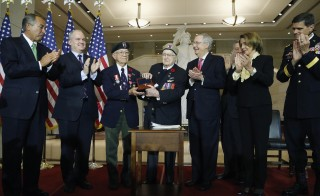 First Special Service Force veterans Eugene Gutierrez  and Charles Mann, of Canada, receive the Congressional Gold Medal during a ceremony honoring them and their fellow members of the First Special Service Force. Photo by Jonathan Ernst/Reuters