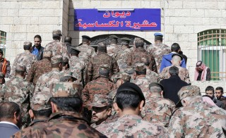 Jordanian soldiers are seen at the headquarters of the family clan of pilot Muath al-Kasaesbeh in the city of Karak Feb. 4, 2015. Jordan hanged two Iraqi jihadists on Wednesday including a female militant in response to an Islamic State video showing captured Jordanian pilot Muath al-Kasaesbeh being burnt alive by the hardline group. Photo by Muhammad Hamed/Reuters