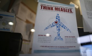 A measles poster is seen at Venice Family Clinic in Los Angeles, California February 5, 2015. Lawmakers in several U.S. states are backing proposals to make it harder for parents to opt out of school vaccinations based on personal beliefs, as health officials fight a growing measles outbreak that has sickened more than 100 people in more than a dozen states. Photo by Lucy Nicholson/Reuters