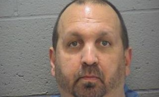 Craig Stephen Hicks, 46, of Chapel Hill appears in a police booking photograph provided by the Durham County Sheriff in North Carolina on Feb. 11. Hicks has been arrested and charged with fatally shooting three people near the University of North Carolina at Chapel Hill campus on Tuesday, police said. Photo from Durham County Office of the Sheriff via Reuters