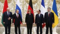 Belarus' President Lukashenko, Russia's President Putin, Ukraine's President Poroshenko, Germany's Chancellor Merkel and France's President Hollande pose for a family photo during peace talks in Minsk