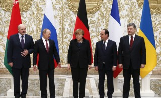 Belarus' President Lukashenko, Russia's President Putin, Ukraine's President Poroshenko, Germany's Chancellor Merkel and France's President Hollande pose for a family photo during peace talks in Minsk
