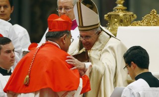 Pope Francis embraces newly elevated Cardinal Francis Xavier Kriengsak Kovitvanit of Thailans during a mass to create 20 new cardinals at a ceremony in St. Peter's Basilica on Feb. 14, 2015. Photo by Tony Gentile/REUTERS.