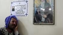 A relative of one of the Egyptian Coptic men killed in Libya mourns at a church before in the south of Cairo