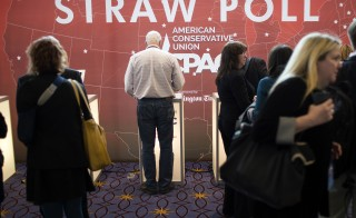 A man takes part in a straw poll at the 42nd annual Conservative Political Action Conference (CPAC) at National Harbor, MD February 26, 2015.      REUTERS/Joshua Roberts    (UNITED STATES - Tags: POLITICS) - RTR4RC7W