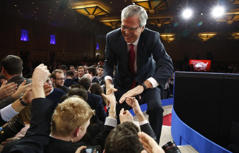 Jeb Bush shakes hands after speaking at Conservative Political Action Conference at National Harbor in Maryland