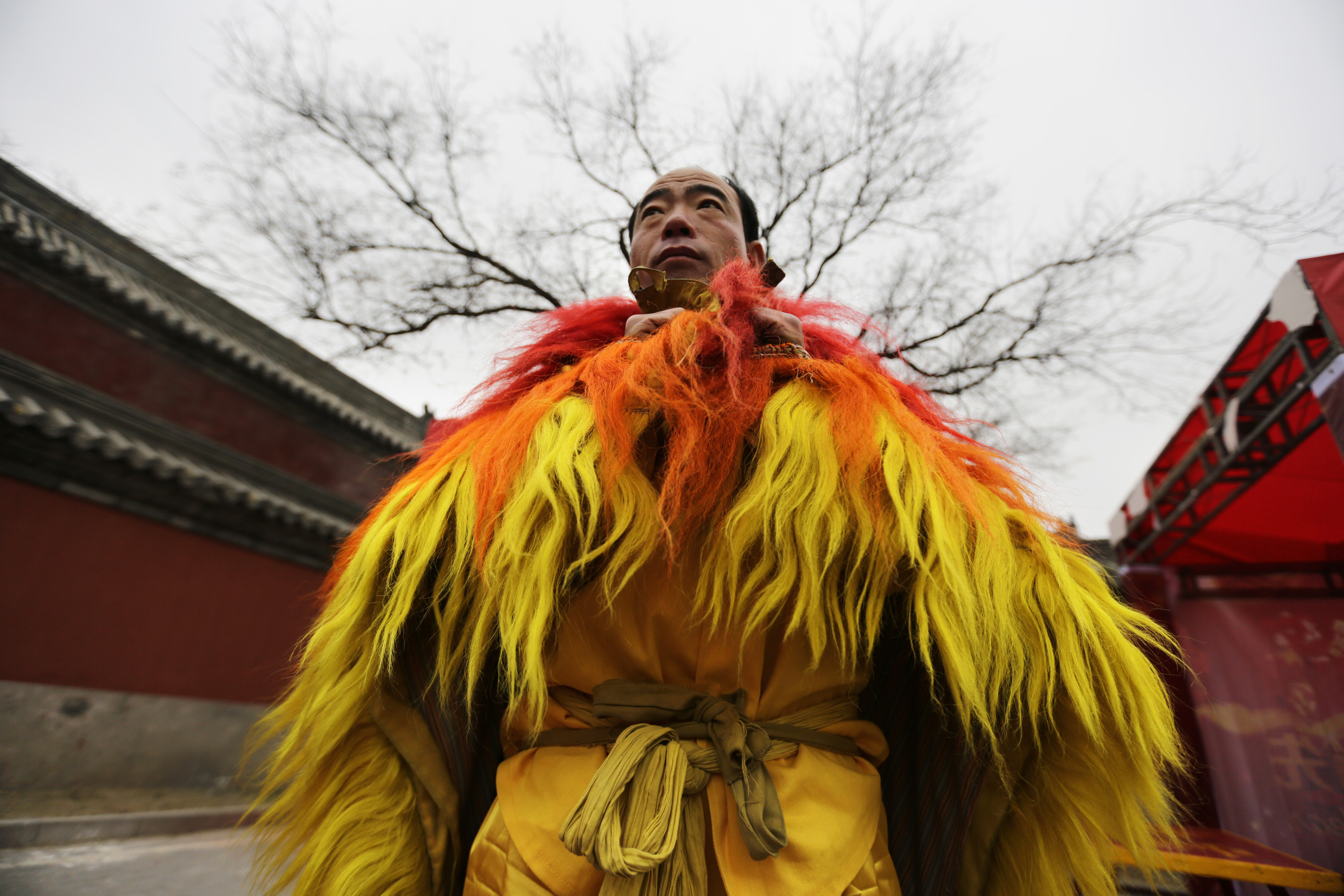 A folk artist waits to perform the lion dance to celebrate the traditional Chinese Spring Festival on the second day of the Chinese Lunar New Year at Dongyue Temple, in Beijing, February 1, 2014. Photo by Jason Lee/REUTERS.