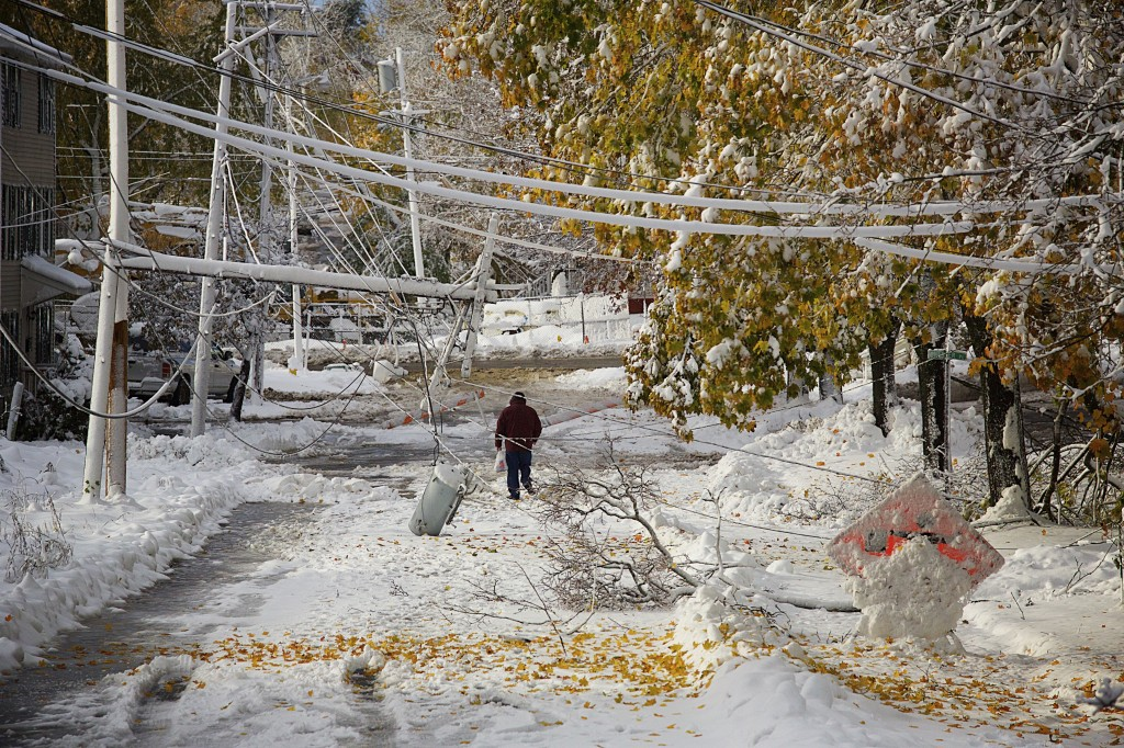 Downed lines on Sanford Street in Bangor left the road closed and area residents unable to leave their homes after a November storm brought several inches of wet snow to central Maine. Photo by Brian Feulner/Bangor Daily News