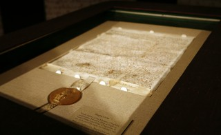 An original version of the Magna Carta on display at Sotheby's auction house in New York December 17, 2007. A 1300 edition of the document from was discovered in a town archive in England. Photo by Shannon Stapleton/Reuters