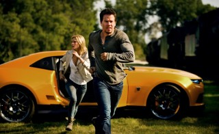 "Mark Wahlberg and Nicola Peltz run, not walk, on screen in Michael Bay's ""Transformers: Age of Extinction."" Photo from Paramount Pictures Facebook page"
