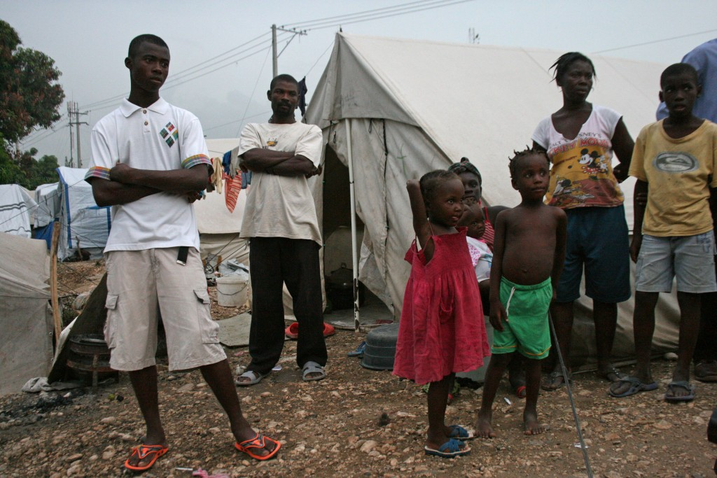 Families in this camp, not far from the U.N. compound in Port au Prince, are frustrated with camp conditions and say there is never enough food and water.