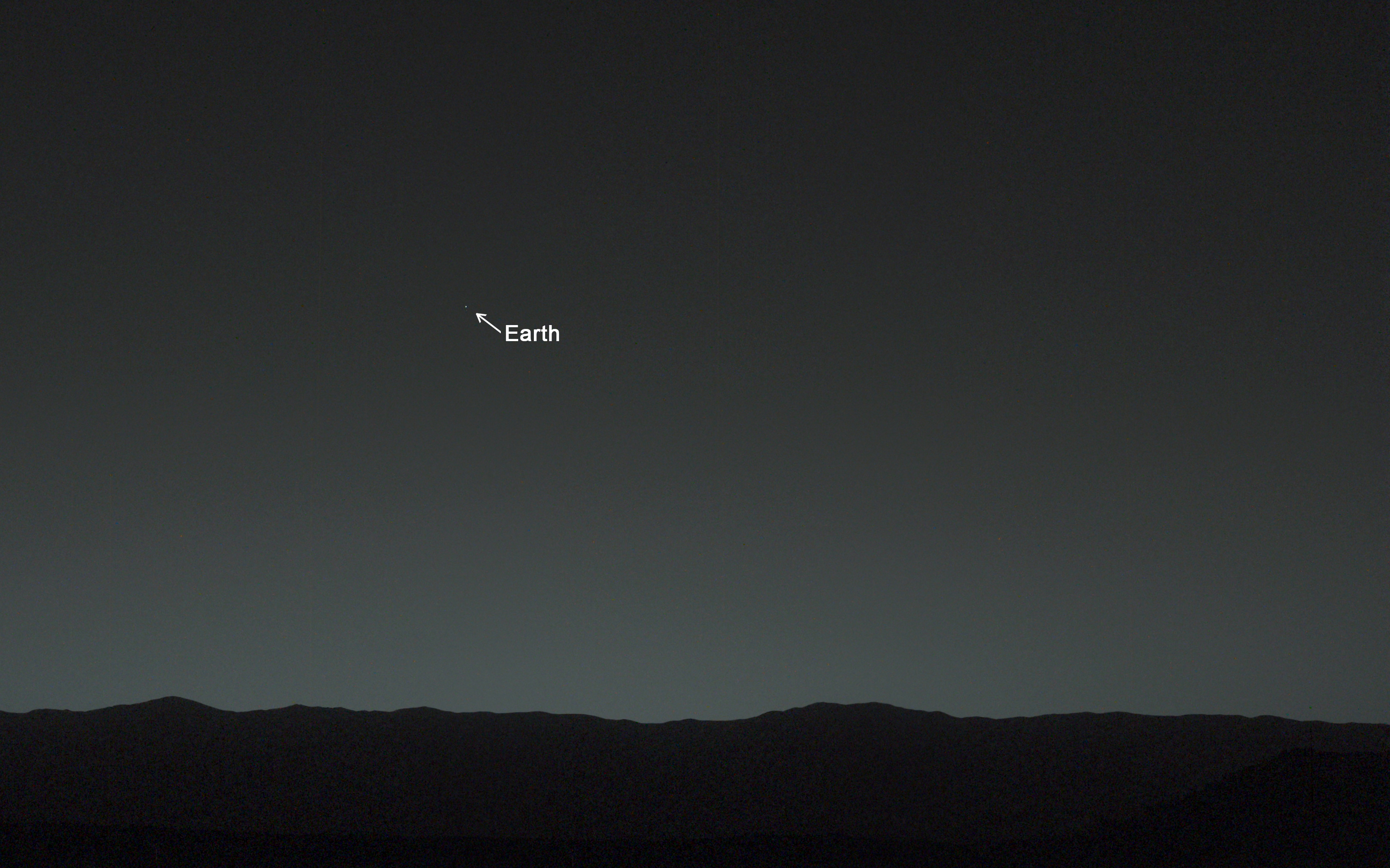 NASA's Curiosity Mars rover captured this image of the Martian horizon 80 minutes after sunset. Earth, the brightest object seen in the twilight sky, is annotated. Image courtesy of NASA/JPL-Caltech/MSSS/TAMU