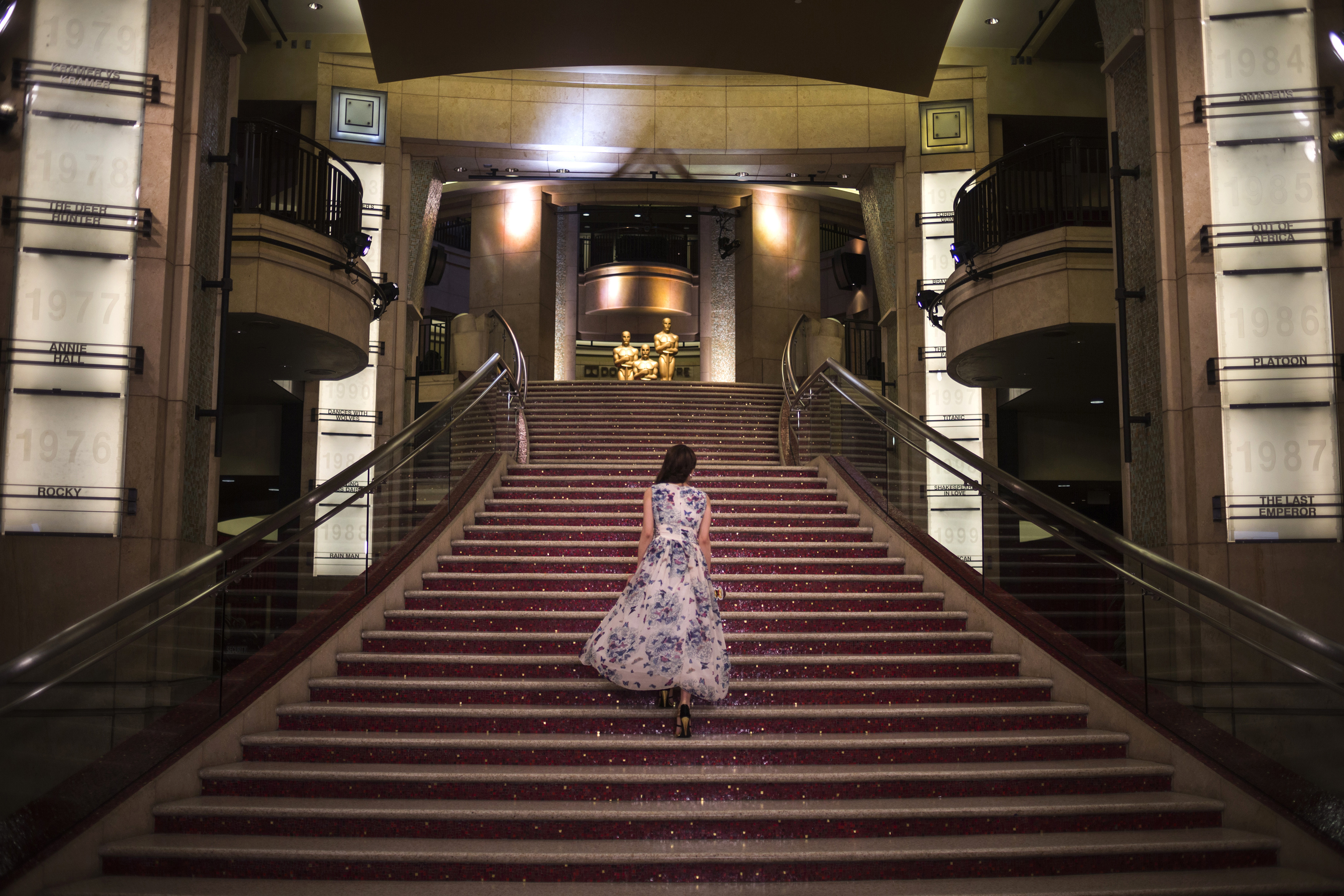 A woman walks up the stairs to the Dolby Theatre in Hollywood, hours before arrivals for the Academy Awards in Los Angeles, California February 22, 2015. Photo by REUTERS/Adrees Latif