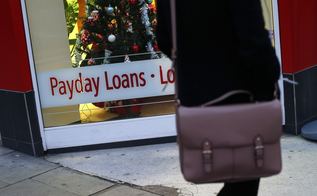 Photo by Suzanne Plunkett/Reuters. A payday loans sign in the window of Speedy Cash, London, December 25, 2013. For the first time, the Consumer Financial Protection Bureau plans to regulate payday loans using authority it was given under the Dodd-Frank law.