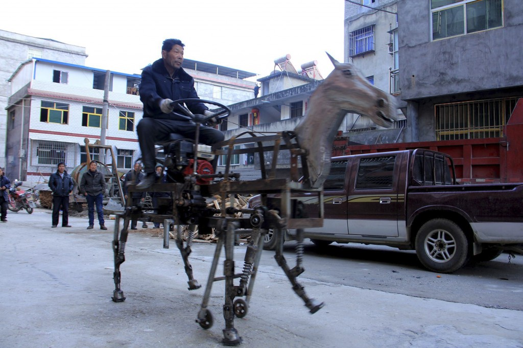 Su Daocheng rides the mechanical horse that he built on a street in Shiyan, Hubei province. Su's robotic horse stands about as tall as an adult human, weighs more than 550 pounds and is the result of two months of work, Chinese media reported. Photo by Reuters/Stringer.