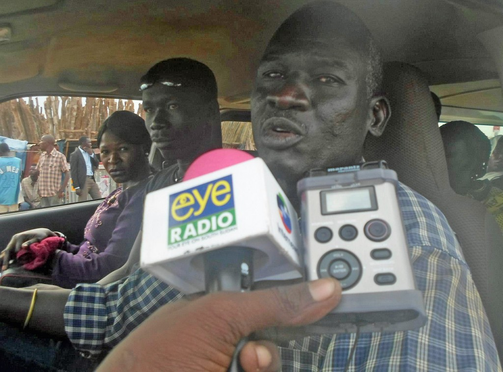 A reporter in South Sudan gets comments from the field. Photo courtesy of Eye Radio
