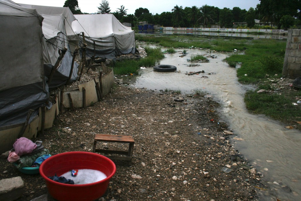 Heavy rains and water diverted from other camps flood this informal camp.