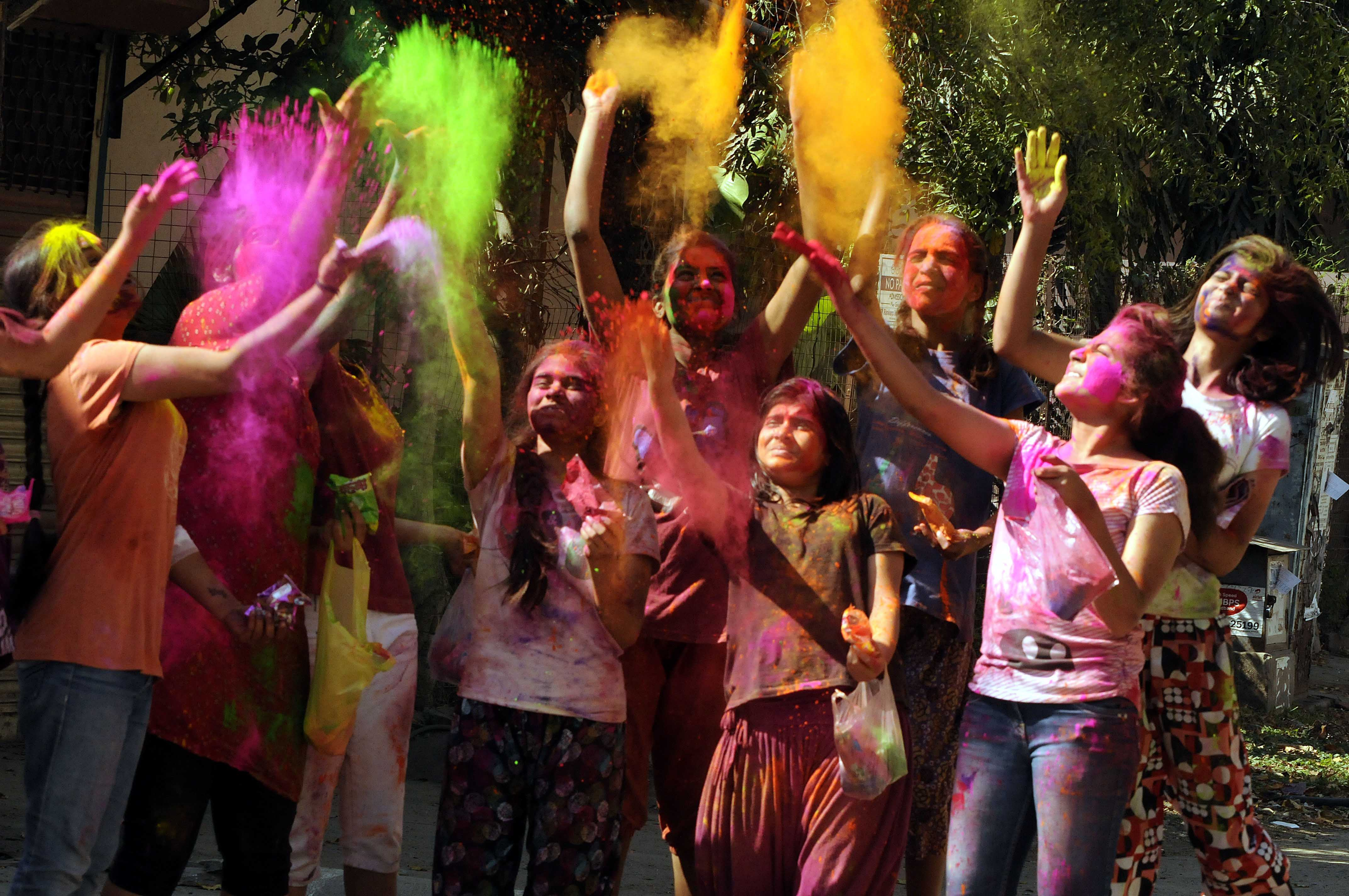 photos revelers let loose during holi festival in pbs children play colors on the occasion of holi the festival of colours