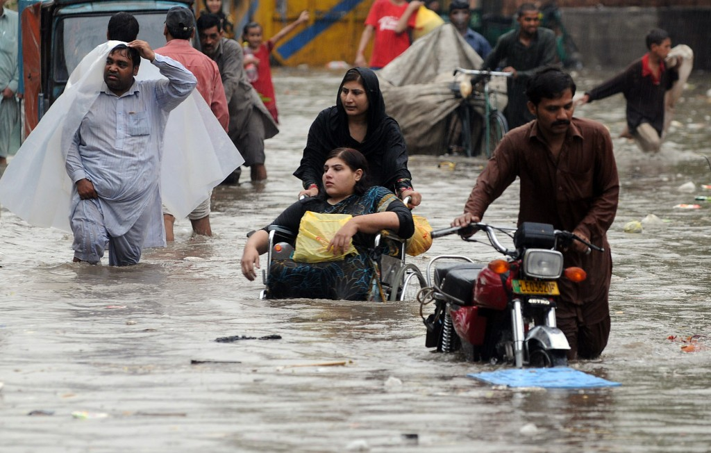 Wading through the streets of Lahore About 2 million people were forced to leave their homes because of the floods. AFP/Getty
