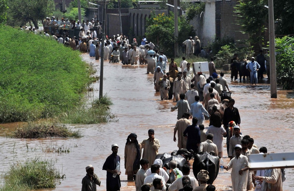 Nowshera district Flood survivors carried belongs as they evacuated their homes, looking for shelter and food aid. AFP/Getty