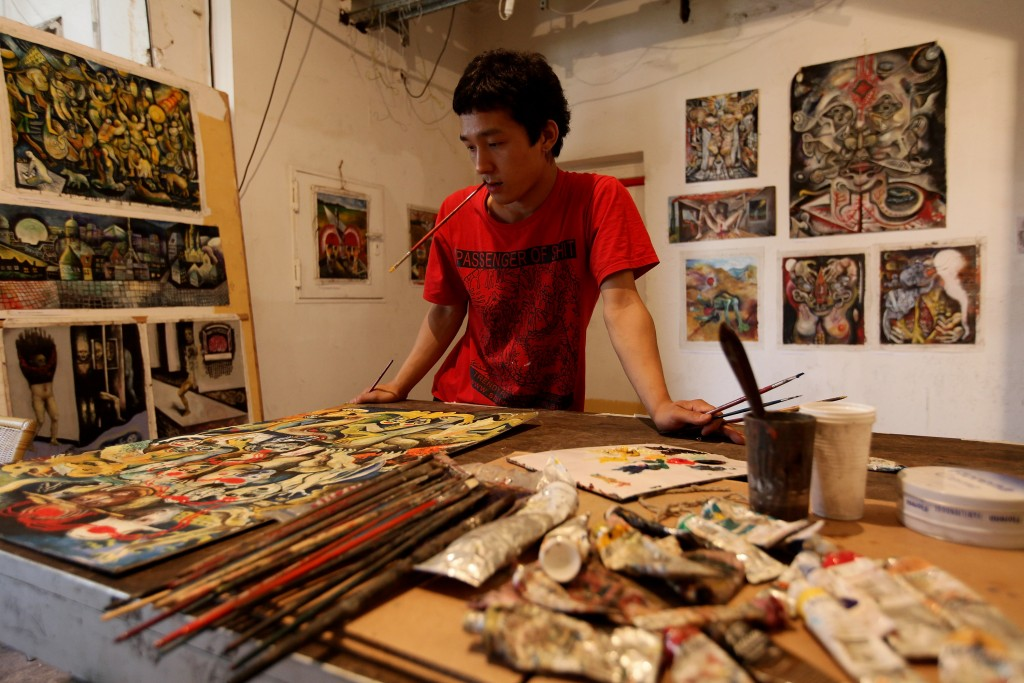 Tacheles Gallery Japanese artist Nono We paints in his studio at the Tacheles Gallery. Photo by Sean Gallup/Getty Images.
