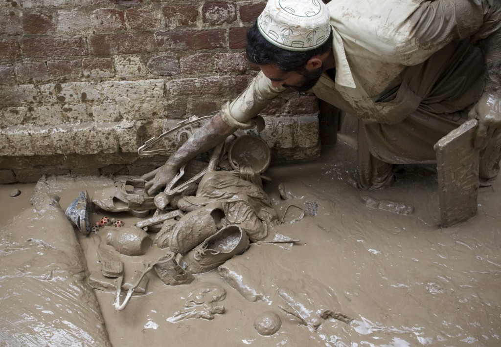 Possessions A Pakistani man gathers some of his belongings from his flooded home. AFP/Getty