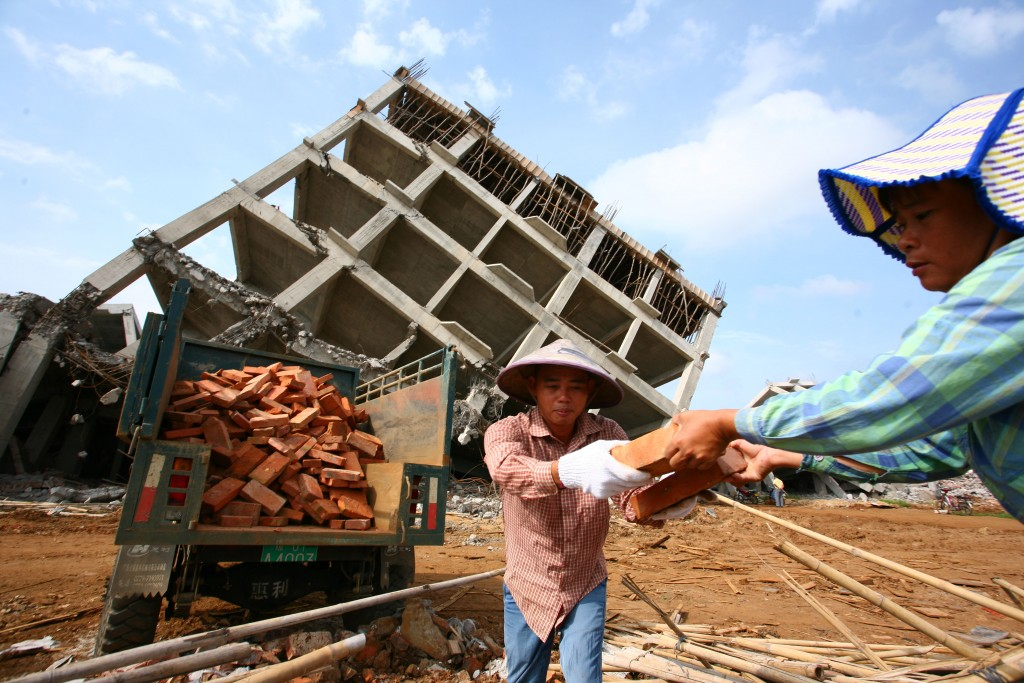 What's Old is New Again Laborers reclaim bricks for recycling at a demolition site on Aug. 6 in Haikou. (ChinaFotoPress/Getty Images)