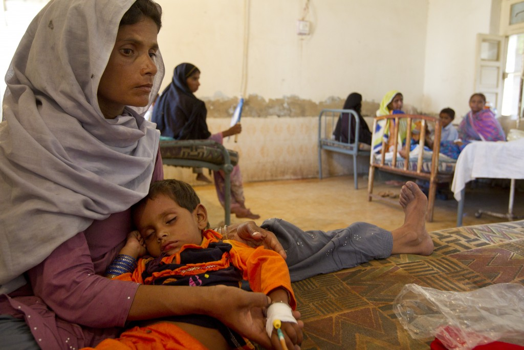 Sick with Diarrhea A woman holds her son suffering from diarrhea at a government hospital. AFP/Getty Images