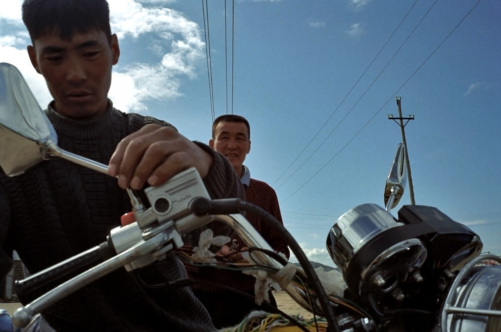 Motorbikes Men repair their motorbike near Ulaanbaatar. Photo by Aletheia Casey/Getty Images.