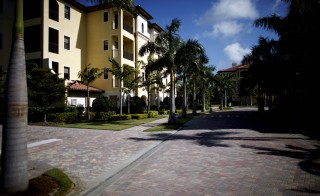 The Naples-Immokalee-Marco Island area of Florida is one of the fastest growing in the country.Palm trees line a street in WCI Communities Inc.'s Marquesa Royale neighborhood at Tiburon in Naples, Florida, U.S., on Thursday, Feb. 24, 2011. Sales in the Naples area last year rose 10 percent, the first annual increase in at least five years, while the median price for homes listed at $300,000 or more gained 4 percent to $544,000, according to data compiled by the Naples Area Board of Realtors. Photographer: Michel Fortier/Bloomberg via Getty Images