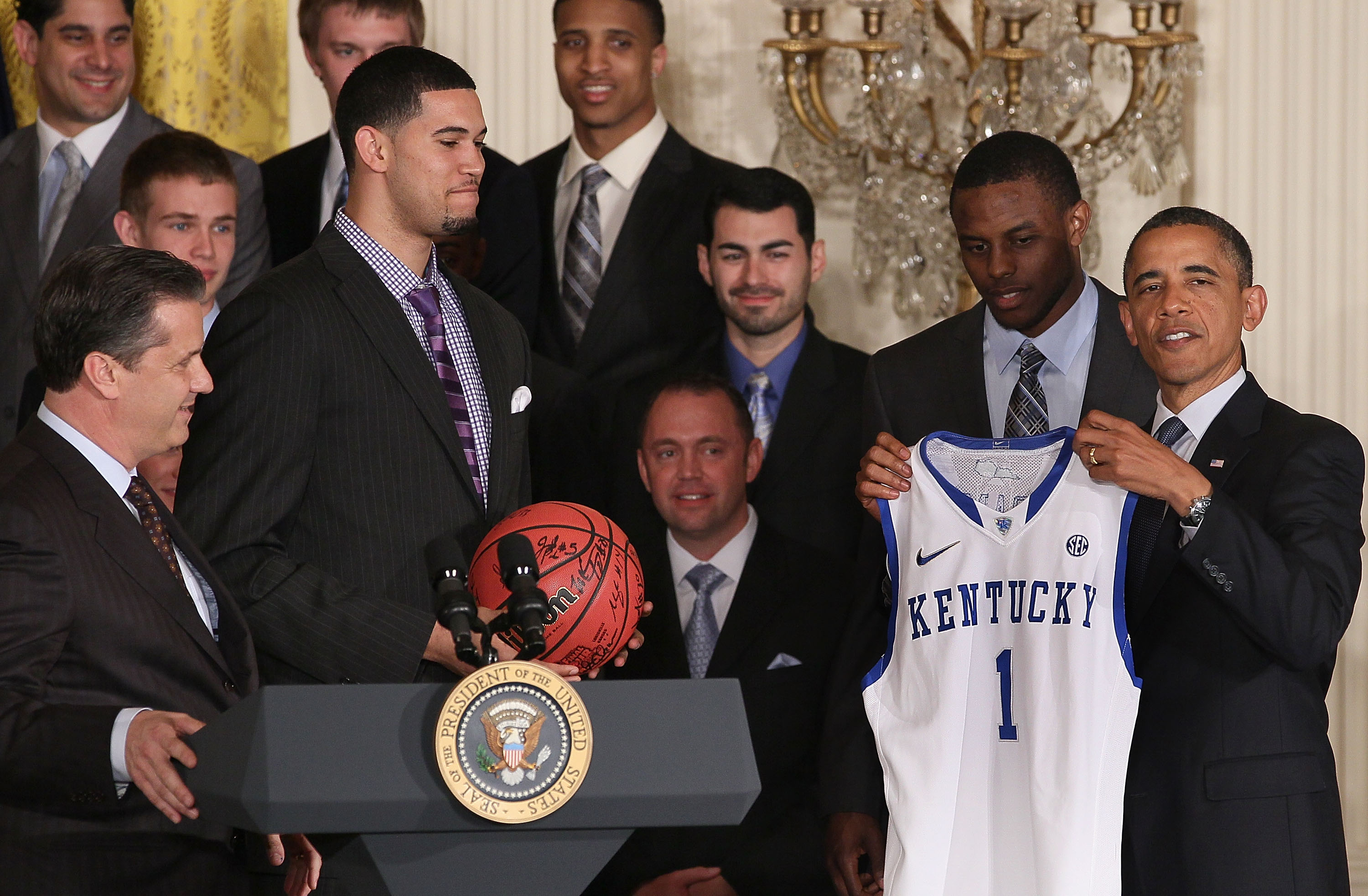 President Barack Obama holds a jersey given to him by the University of Kentucky basketball team during an event in the East Room at the White House, on May 4, 2012. President Obama picked Kentucky to win the NCAA basketball  national championship this year on his bracket that he filled out for ESPN. Photo by Mark Wilson/Getty Images