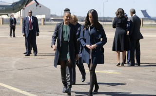 U.S. President Barack Obama's daughters Sasha (L) and Malia (R) arrive with their parents aboard Air Force One at Maxwell Air Force Base in Montgomery, Alabama March 7, 2015 to commemorate the 50th anniversary of a march that sparked the 1965 Voting Rights Act. Photo by Johnathon Ernst/Reuters
