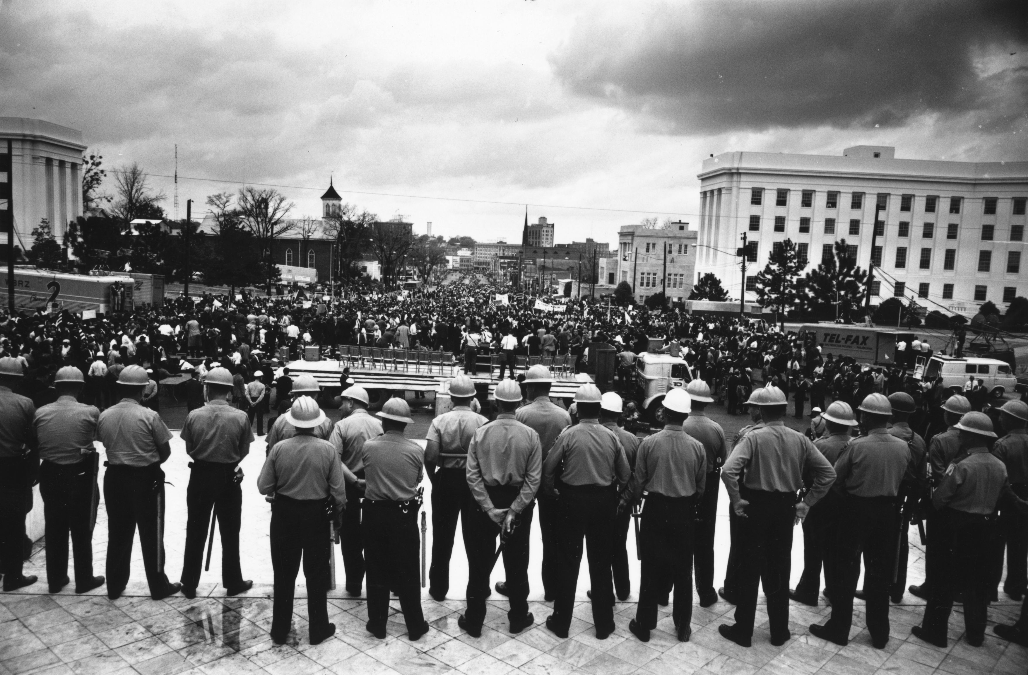 March 1965: A line of policemen on duty during a black voting rights march in Montgomery, Alabama. Dr Martin Luther King led the march from Selma, Alabama, to the state capital in Montgomery. (Photo by William Lovelace/Express/Getty Images)