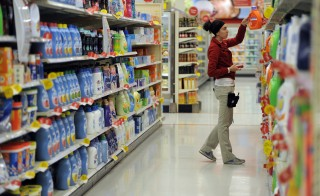 Team member Kelsey Perez stocks the shelves with laundry detergent November 24, 2014 at the Glendale Target. The Glendale Target store gives a behind-the-scenes look at Black Friday preparations. (Photo By John Leyba/The Denver Post via Getty Images)