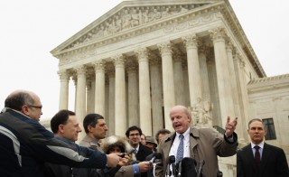 Michael Carvin, 2nd R, lead attorney for the petitioners and partner at Jones Day, speaks to members of the media as Attorney General of Oklahoma Scott Pruitt, R, listen outside the U.S. Supreme Court after oral arguments March 4, 2015 in Washington, DC. The Supreme Court heard oral arguments in the case of King v. Burwell. Photo by Alex Wong/Getty Images