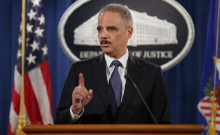 Attorney General Eric Holder delivers remarks about the Justice DepartmentÕs findings related to two investigations in Ferguson, Missouri, at the Robert F. Kennedy Department of Justice Building March 4, 2015 in Washington, DC. Holder delivered the remarks for an audience of department employees who worked on the investigations after a white police officer shot and killed an unarmed black teenager, sparking weeks of demonstrations and violent clashes.