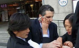 U.S. Ambassador to South Korea Mark Lippert was attacked by a man with a razor blade while giving a lecture in Seoul on March 5, 2015. Photo by The Asahi Shimbun via Getty Images
