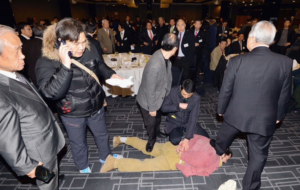 In this handout image provided by The Asia Economy Daily newspaper, the man identified as Kim Ki-jong is arrested at the site in Seoul where U.S. Ambassador to South Korea Mark Lippert was attacked on March 5, 2015. Photo by Handout/The Asia Economy Daily via Getty Images