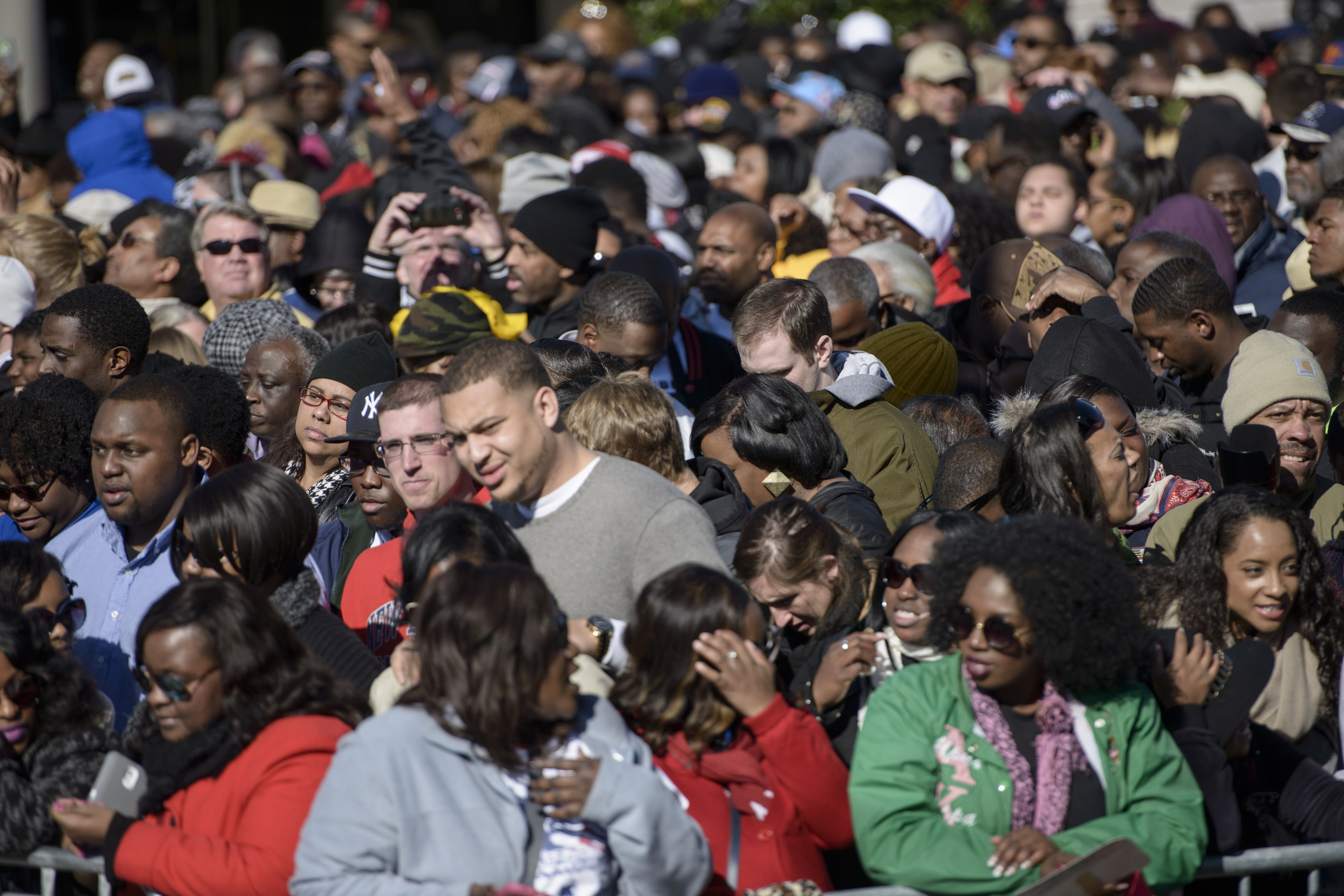 People fill Broad Street while waiting for an anniversary event at the Edmund Pettus Bridge March 7, 2015 in Selma, Alabama. US President Barack Obama and the first family will visit Selma to commemorate the 50th anniversary of Bloody Sunday, when civil rights marchers attempting to walk to the Alabama capital of Montgomery to end voting discrimination against African Americans clashed with police. AFP PHOTO/BRENDAN SMIALOWSKI (Photo credit should read BRENDAN SMIALOWSKI/AFP/Getty Images)